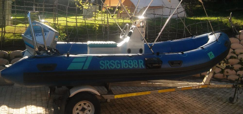Very Neat and Tidy Suzuki Hard-bottom dinghy for sale!