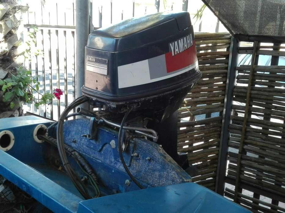 Boat on trailer with 50 yamaha motor