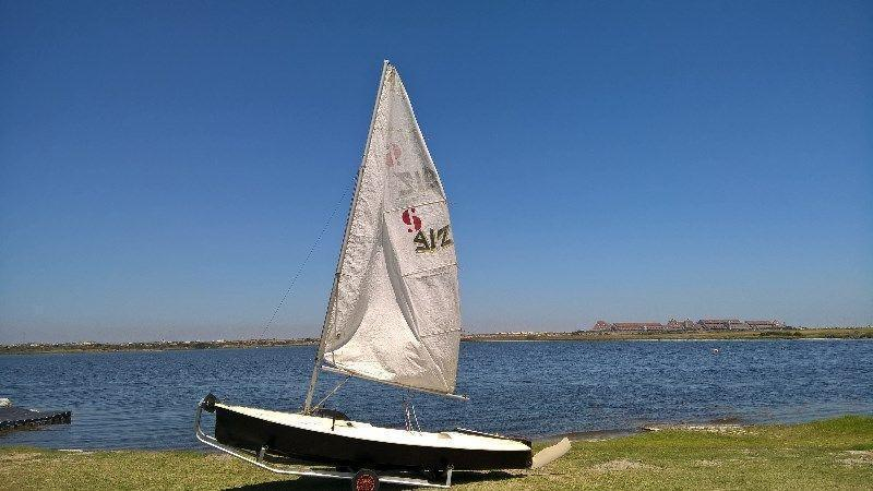 Sprog Fibreglass Sailing Dinghy on galvanised dolly
