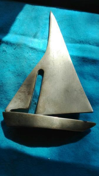 Small brass sailing yacht