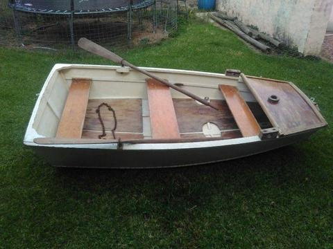 Wooden Row Boat with Oars Crutches and an Anchor